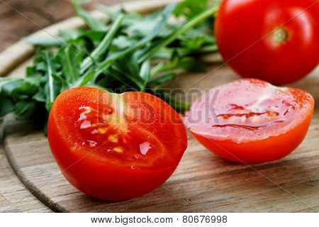 The Cut Tomatoes And Green Salad