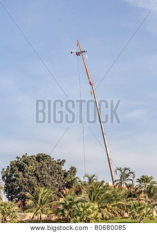The Photo Of Hoisting Crane Working For Telecommunication Site And Antenna Tower.
