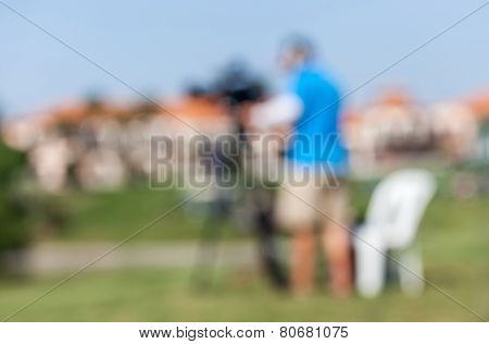 Blurred Image Of Sport Photographers Working At The Golf Tournament