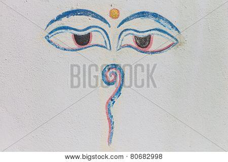 Eyes Of Buddha On White Concrete Background