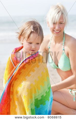 An Interested Girl And Her Mother At The Beach