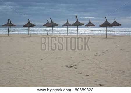 Sand Beach With Footpath And Parasols