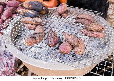 Burned Sweet Potato On Charcoal Grill
