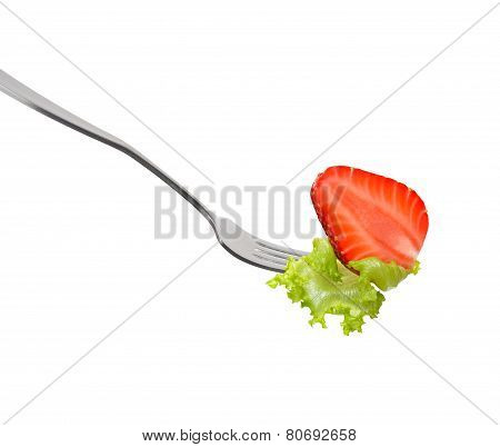 Mixed salad on fork