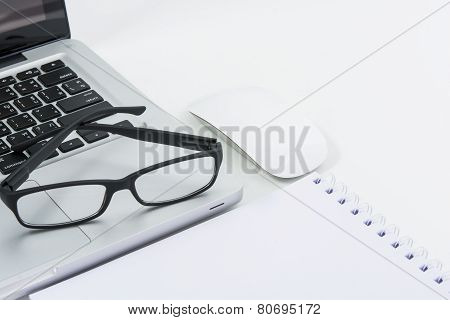 Blank Business Laptop, Mouse, Pen, Glasses And Note