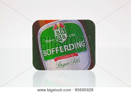 Beermat From Bofferding Beer On A Glass Table.