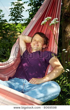 Happy Man In Hammock