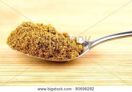 Macro Closeup Of Crushed Cumin Seeds In Spoonful