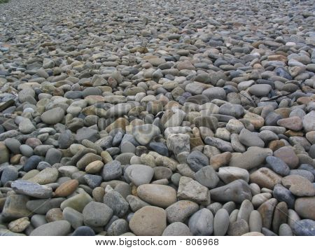 Guijarros por el lado de la playa