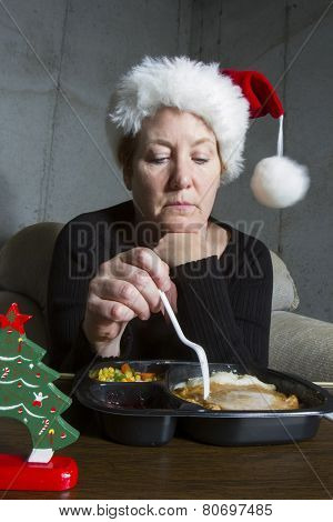 Sad Woman Eating Christmas Dinner Alone