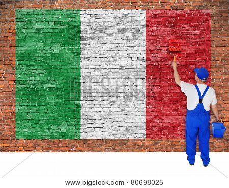 House Painter Paints Flag Of Italy On Brick Wall