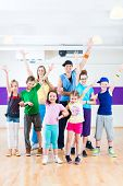 image of zumba  - Dance teacher giving children Zumba fitness class in gym - JPG