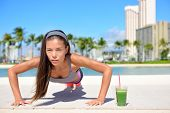 picture of fitness  - Healthy lifestyle fitness woman exercising drinking green vegetable smoothie doing push - JPG