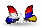 stock photo of armenia  - Two butterflies with flags on wings as symbol of relations Holland and Armenia - JPG
