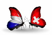 picture of holland flag  - Two butterflies with flags on wings as symbol of relations Holland and Switzerland - JPG