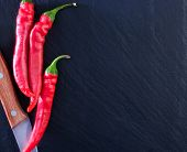 picture of red hot chilli peppers  - red hot chilli peppers on the black table - JPG