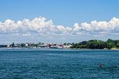 foto of cape-cod  - Blue skies with puffy clouds off the coast of Cape Cod in Massachusetts - JPG