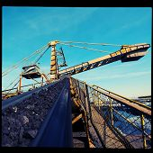foto of iron ore  - conveyor transport for loading iron ore from the warehouse - JPG