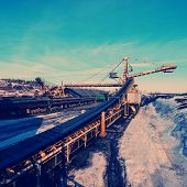 picture of iron ore  - conveyor transport for loading iron ore from the warehouse - JPG
