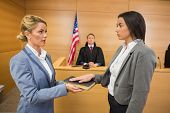 foto of court room  - Witness taking an oath in the court room - JPG
