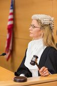 pic of court room  - Stern judge sitting and listening in the court room - JPG