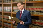 stock photo of lawyer  - Handsome lawyer in the law library at the university - JPG