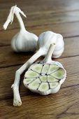 picture of naturopathy  - Garlic and cloves of garlic on wood - JPG