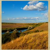 picture of steppes  - rural landscape steppe river and clouds on the sky background - JPG