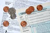 image of income tax  - tax forms and coins tax concept background - JPG
