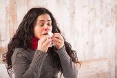 stock photo of sneezing  - Sneezing beauty - JPG