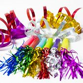 stock photo of blowers  - Party Horn Blower with colored streamers on white background - JPG