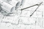 stock photo of outline  - Construction blueprints planning drawings on the worktable and architectural instruments - JPG