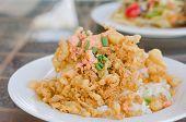 stock photo of crispy rice  - fried crispy beaten egg omelette served with steamed rice - JPG