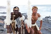 stock photo of zulu  - two african zulu dancers on the beach in traditional clothing - JPG