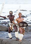 image of zulu  - two african zulu men posing on beach in traditonal clothing - JPG