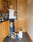 image of mother child  - Family in the kitchen children playing with their toys - JPG