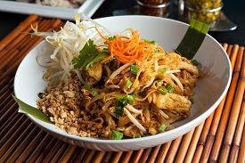 picture of stir fry  - Chicken pad Thai dish of stir fried rice noodles with a contemporary presentation - JPG