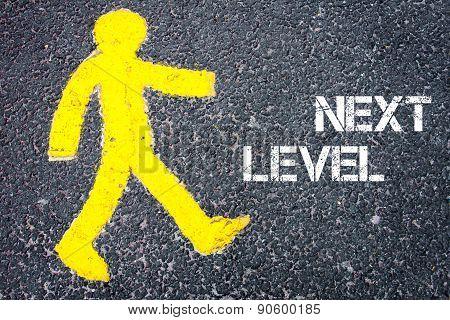 Yellow Pedestrian Figure Walking Towards Next Level