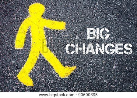 Yellow Pedestrian Figure Walking Towards Big Changes