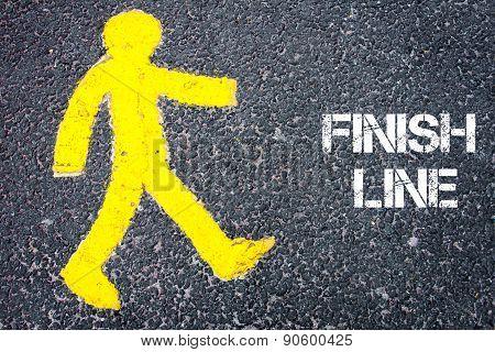 Yellow Pedestrian Figure Walking Towards Finish Line