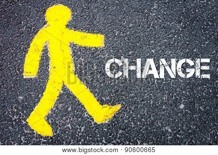 Yellow Pedestrian Figure Walking Towards Change