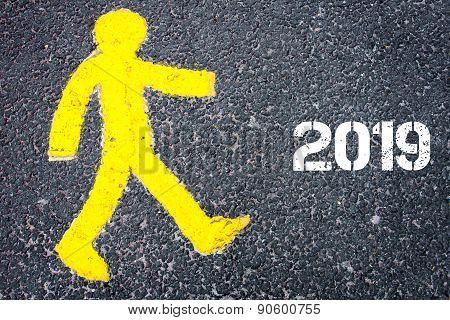 Yellow Pedestrian Figure Walking Towards Year 2019