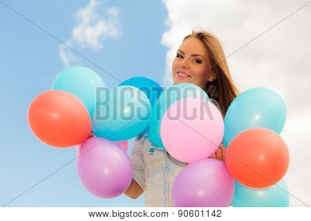 Teen Girl With Colorful Balloons