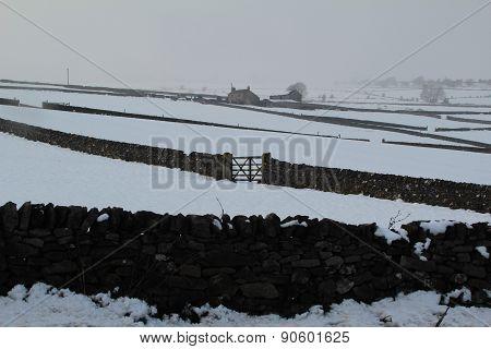 Farm building in snow Peak District