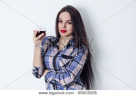 Attractive girl with a glass of red wine