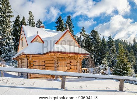 Mountain hut with closed windows in winter