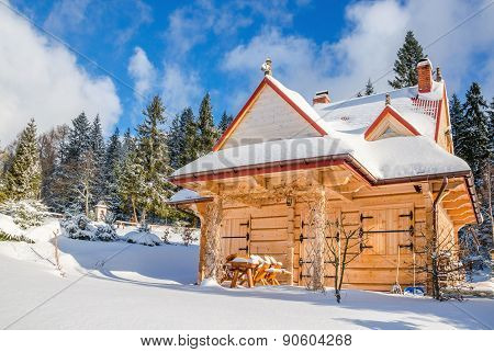 Spring comming to closed mountain hut in winter