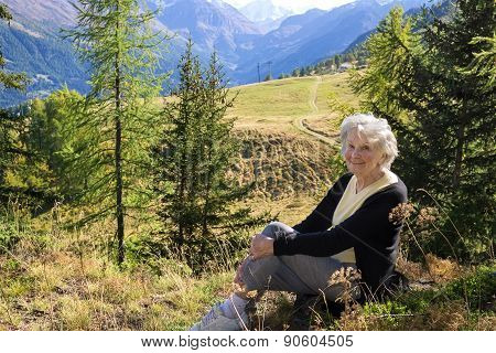 Elderly Lady Enjoying A Vacation In The Mountains.