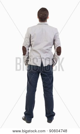 back view of Business man  looks.  Rear view people collection.  backside view of person.  Isolated over white background.  Sad man looking upward with his hands in his pockets.
