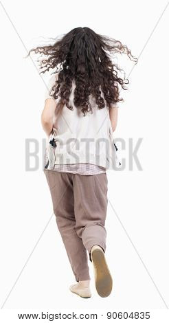 back view of running  woman. beautiful girl in motion. backside view of person.  Rear view people collection. Isolated over white background. curly girl with flowing hair runs